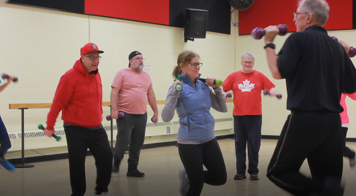 Young Onset Dementia Program participants in a group exercise session.
