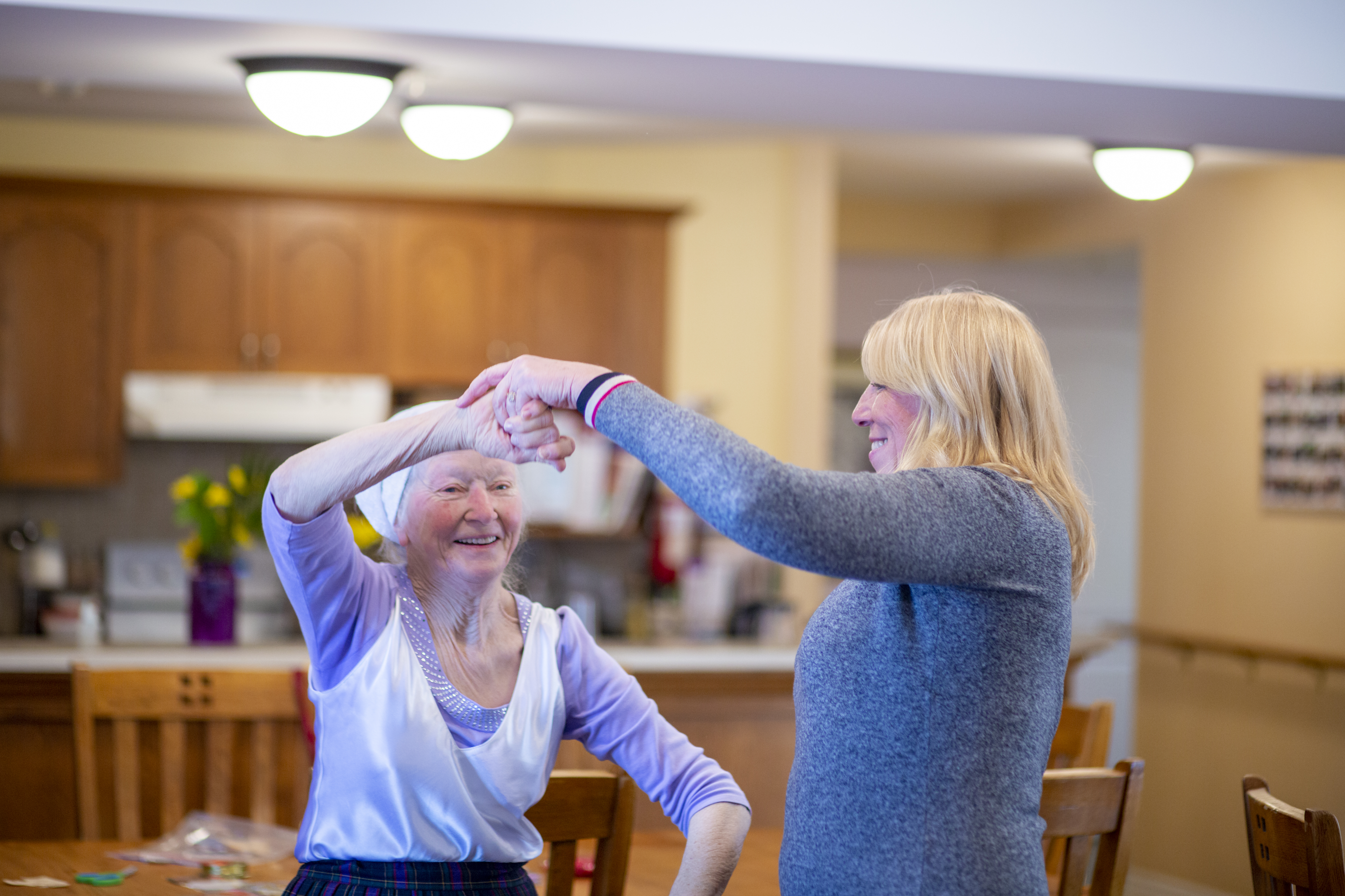 Richmond Care Home resident (left) dancing with staff member.