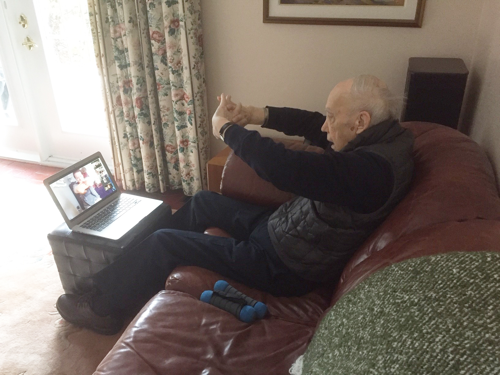 Vital, Alison's husband, participating in a virtual exercise session.